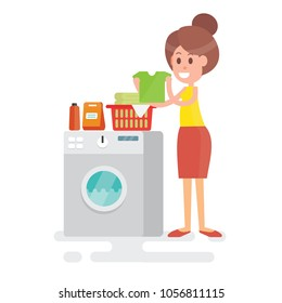 Woman housewife with t shirt clothes in his hands next to the washing machine