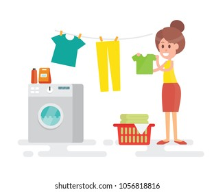 Woman housewife washing clothes and hang clothes on a rope