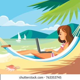 Woman with laptop at the beach