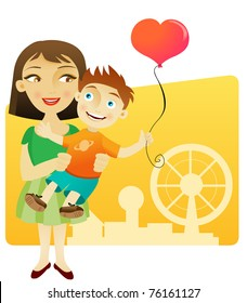 Woman and little boy having fun in the park with a balloon