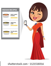 A woman is looking at a recipe website/ app on her mobile phone with recipes of wholesome Indian food and winking