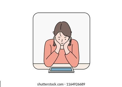 The woman is looking at the tablet with both hands clasping her chin. hand drawn style vector design illustrations.