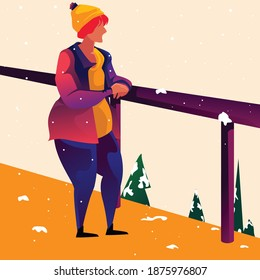 A woman with orange hair, a hat, and coat, walks alone in winter, contemplatively looking out over the landscape, leaning on a railing above pine trees.