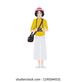 Woman photographer holding photo camera and photographing. Creative profession or occupation. Cute female cartoon character isolated on white background. Colored vector illustration in flat style.