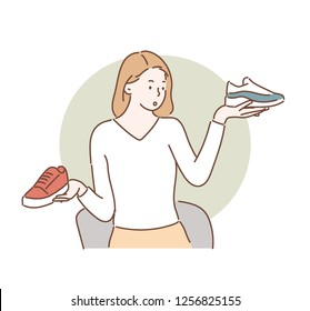A woman is picking up two shoes with her choice. hand drawn style vector design illustrations.