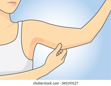 Woman pull skin upper arm area for checking her arm size.
