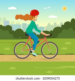 Woman riding a bicycle in a park