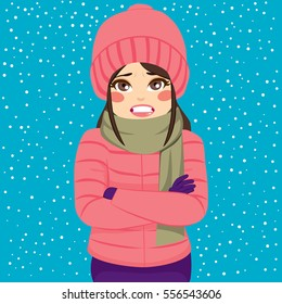 Woman shivering in cold winter outdoors wearing warm clothes on snowy day