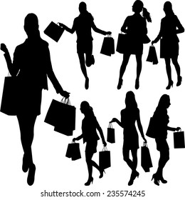 woman with shopping bags silhouettes