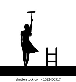 Woman silhouette painting the wall