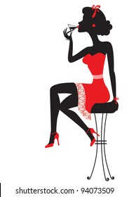 Woman is sitting and drinking martini in red dress on white