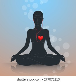 Woman is sitting in lotus position and meditating. Dark silhouette on blue-brown background. Listen to your heart and live in harmony