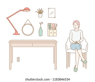 A woman sitting on a chair, a table and various objects. hand drawn style vector design illustrations.