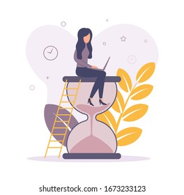 A woman is sitting on an hourglass. Woman with a laptop. Woman working on a laptop while sitting on an hourglass