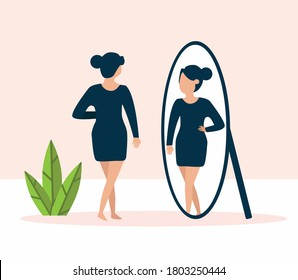 woman standing in front of mirror and looking at reflection looking