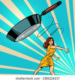 woman throws a frying pan. Pop art retro vector illustration vintage kitsch 50s 60s