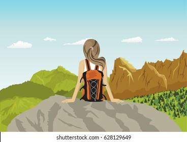 woman traveler sitting on rocks looking at mountains