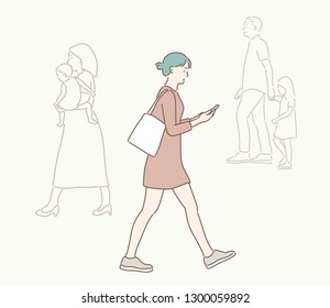 A woman is walking down the street watching a cell phone. hand drawn style vector design illustrations.