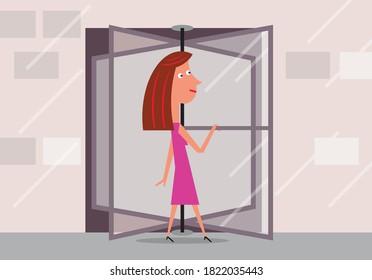Woman walking into revolving door