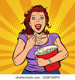 Woman watching a movie, smiling and eating popcorn. Fast food in the cinema hall. Pop art retro vector illustration comic cartoon vintage kitsch