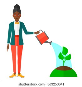Woman watering tree.