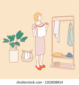 A woman is wearing a coat hanging on a hanger. Background decoration objects. hand drawn style vector design illustrations.