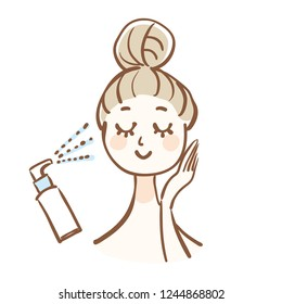 A woman who is doing skin care.She is using a moisturizing mist.