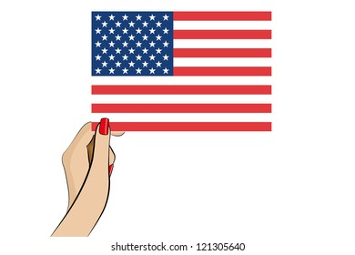 A womans hand holding the flag of the United States of America