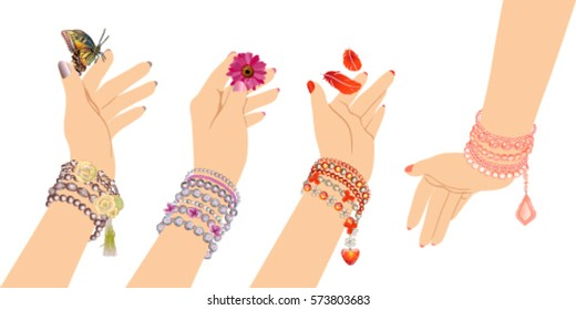 woman's hands with bracelets of beads on a white background