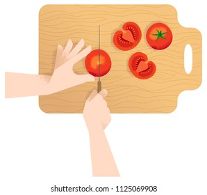 Womans hands slicing a tomatoe with a knife on wooden cutting board - flat lay.