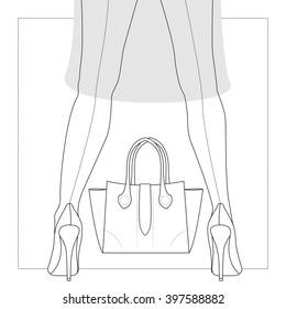 Woman's legs in high heel shoes and stylish handbag