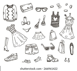 Women clothes and accessories, hand drawn doodle set