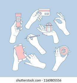 Women hands set. Hands holding smartphone, credit card, tube, cup, gift and pencil. Feminine illustration. Vector illustration