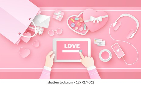 Women are searching for Love on tablet in Valentine's day with decorated items and accessories in pink set on desk. Desk design of Love. paper cut and craft style. vector, illustration.