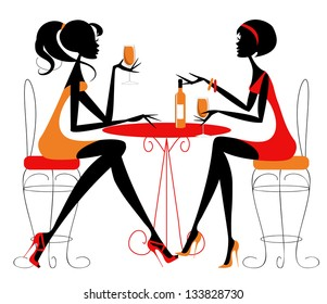 Women sharing a bottle of wine Two female friends chatting over a bottle of wine