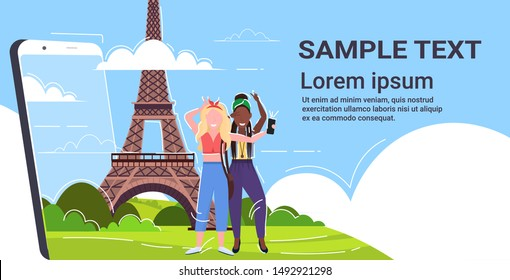 women taking selfie photo on cellphone camera mix race girls standing together travel concept paris abstract city silhouette background smartphone screen copy space flat full length horizontal