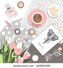 women's beauty flatlay in pink and gray with tulips, coffee and cosmetics.
