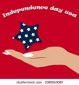 women's hand holding a star for us Independence Day