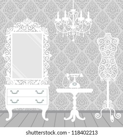 Women's room in vintage, boudoir style with mannequin, chandelier, mirror, table and telephone