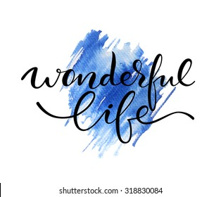 Wonderful life lettering. Hand drawn letters. Modern calligraphy. Abstract blue watercolor background.