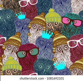 Wonderful owls in seamless pattern. Vector illustration with hand drawn wild birds. Crowd of animals in the winter forest.