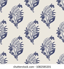 Wood block printed indigo dye seamless ethnic paisley pattern. Traditional oriental ornament of India with hops, navy blue on ecru background. Textile design.