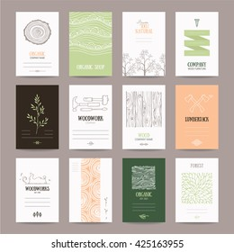 Wood company business card, woodwork ad, furniture manufacture banner, natural goods flyer, organic shop poster. Artistic collection of templates with lumberjack tools, woody textures, tree branches.