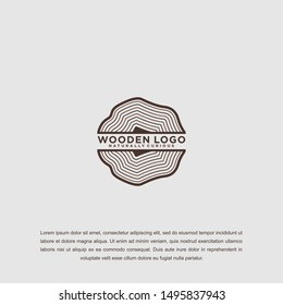 Wood icon or sawmill logo - black vector tree growth rings symbol or sign