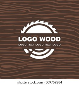 Wood industry symbol with saw and tree rings
