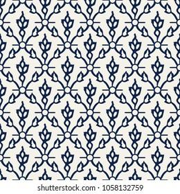 Woodblock printed indigo dye seamless ethnic floral damask pattern. Traditional oriental ornament of India Kashmir, tulip flowers and leaves ogee, navy blue on ecru background. Textile design.