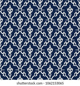 Woodblock printed indigo dye seamless ethnic floral damask pattern. Traditional oriental ornament of India Kashmir, tulip flowers and leaves ogee, ecru on navy blue background. Textile design.