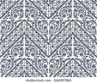 Woodblock printed indigo dye seamless ethnic geometric pattern. Traditional oriental floral ornament of India Kashmir and chevron motif, navy blue on ecru background. Textile design.