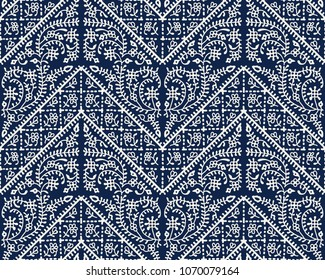 Woodblock printed indigo dye seamless ethnic geometric pattern. Traditional oriental floral ornament of India Kashmir and chevron motif,  ecru on navy blue background. Textile design.