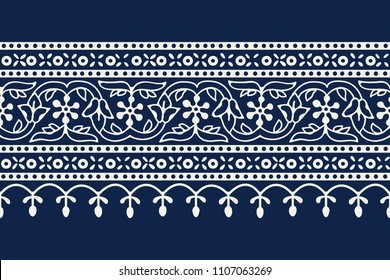 Woodblock printed indigo dye seamless ethnic floral geometric border. Traditional oriental ornament of India Kashmir, flowers wave and arcade motif, ecru on navy blue background. Textile design.